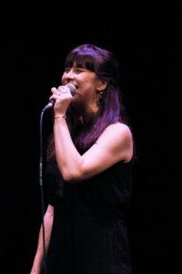 Eva Scholten singing and smiling
